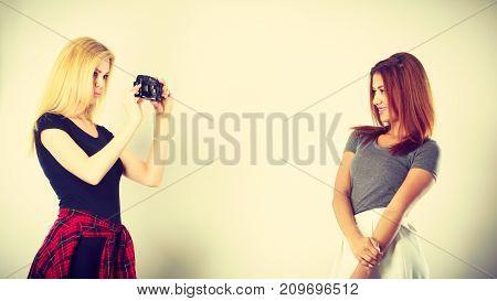 Blonde Girl Photographing Mulatto Woman