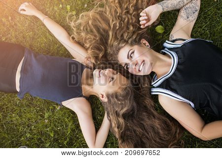 Mother care, conscious motherhood, strong female friendship, happiness together concept. Happy summer life. Beautiful smiling family on nature background