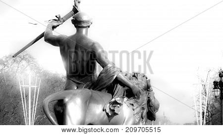 This is Progress (a nude youth holding a flaming torch) Bronze sculpture on the Queen Victoria Memorial London UK