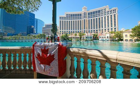 LAS VEGAS - OCT 10 ,2017 : Canadian flag with messages of the Las Vegas Shooting victims front of the Bellagio.