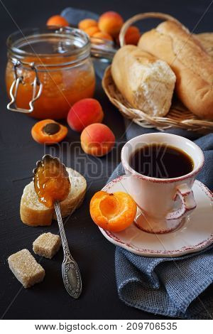 Still life: Apricots apricot jam in jam jar and cup of coffee