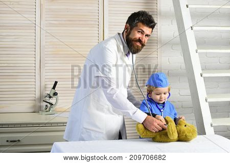 Father And Kid With Happy Faces Play Doctor