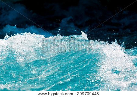 background of stormy water splashes . Photo of an abstract texture