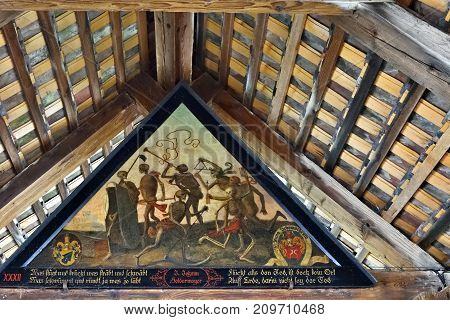 Lucerne Switzerland - June 14 2017: Dance of Death ancient painting (1635) by Meglinger at Spreuer Bridge. German text means No place in the World where death is not present