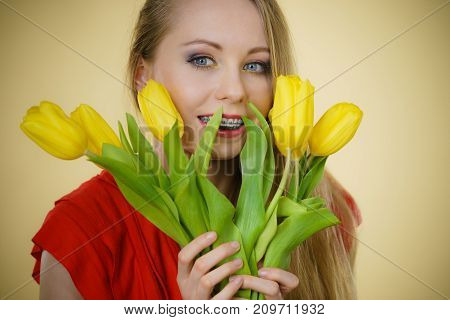 Pretty Woman With Yellow Tulips Bunch