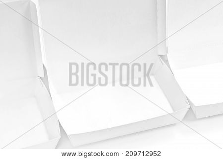 Blank paper package white box for food products on the white background.