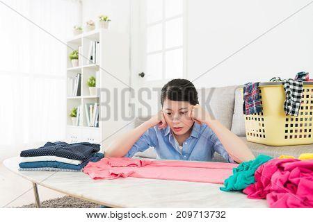 Pretty Woman Looking At Tshirt Feeling Bored
