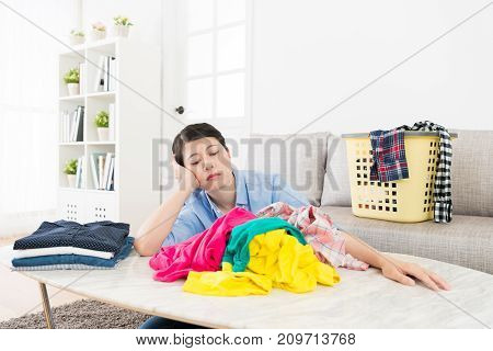 Unhappy Beautiful Woman Sitting In Living Room