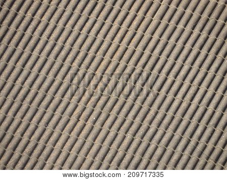 Gray tiles roof background seen from above