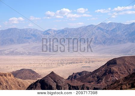 Aerial landscape in Eilat Mountains and Jordan mountain range on the background.