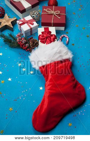Christmas presents flowing out of Santa's stocking