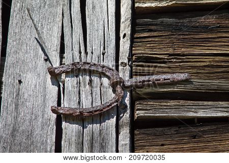 antique rusty iron metal barn door hinge