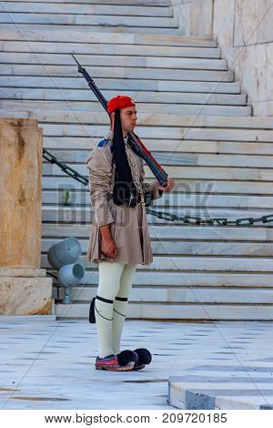 ATHENS, GREECE - JUNE, 2011: Evzone guard on Synrtagma Square, the central square in the city. Popular tourist attraction
