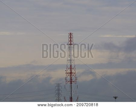 Telecommunication tower Antenna The background is sky.