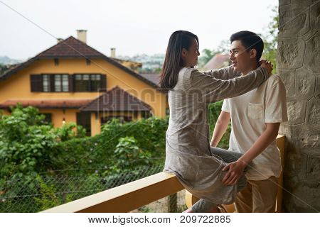 Young couple in love spending time on hotel balcony