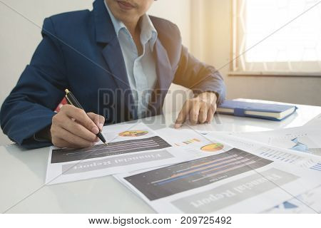 Business man calculate about cost and doing finance at office Finance managers taskConcept business and finance investment