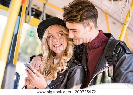 Couple With Smartphone In Bus
