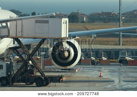 Engine of airplane in airport, preparing for take-off, telephoto shot