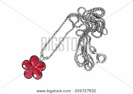 Red crystal flower pendant on silver chain isolated over white