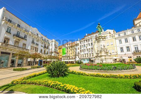 Largo de Portagem square in a beautiful sunny day with blue sky. Historic center of Coimbra in Central Portugal, Europe.