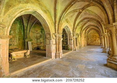 Colonnade in old Cathedral of Coimbra. Se Velha de Coimbra, is one of most important romanesque buildings in Portugal and a popular landmark in Coimbra, central Portugal.