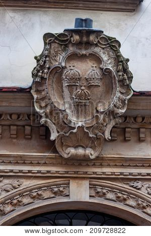 KRAKOW, POLAND - JUNE, 2012: ARCHITECTURAL DECORATION WITH COAT OF ARMS ON WALL CLOSE UP