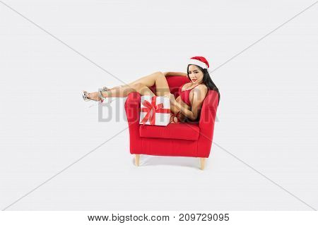 Beautiful happy woman in sexy Santa Claus clothes.