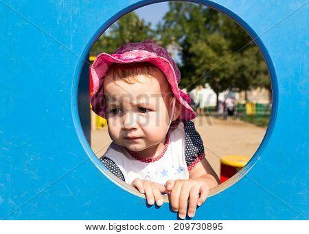 Portrait of a sad little baby .