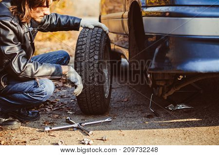 Change a flat car tire on road with Tire maintenance damaged car tyre