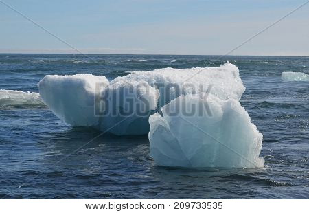 Beautiful white icebergs floating on the waters of Iceland