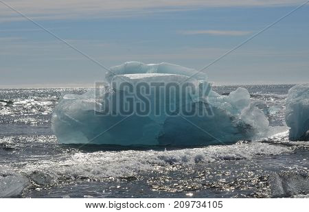 Icelandic waters with a large iceberg in the summer