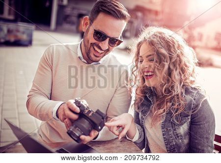 Young couple taking photo picture in the city.Autumn,holidays and dating concept.