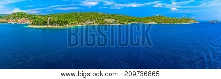 Seafront coastline panorama at Vis island in summertime, well-known tourist resort in South of Croatia, Mediterranean.