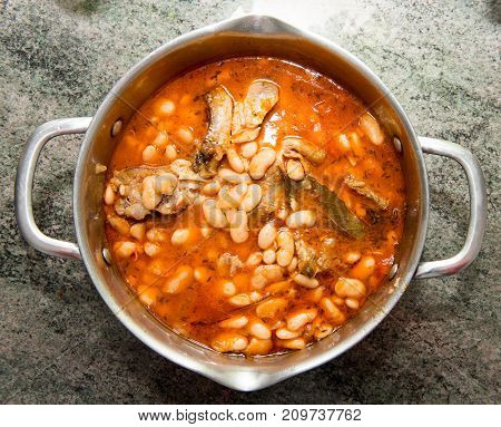 sheep stew with white beans in a saucepan