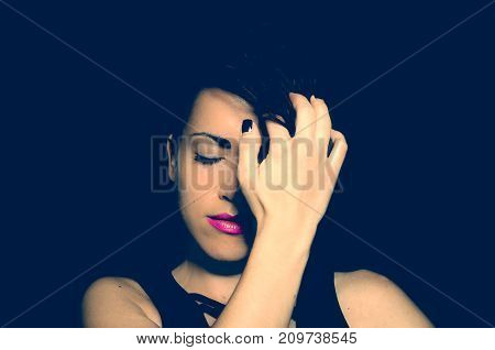 Portrait of young girl with calm face and light smile after she realized that there is no reason for frustration on dark not isolated background