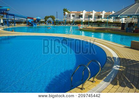 Sharm El Sheikh, Egypt - September 23, 2017: The people resting at pool at luxury hotel Dreams Beach Resort Sharm 5 stars at Sharm El Sheikh, Egypt on September 23, 2017