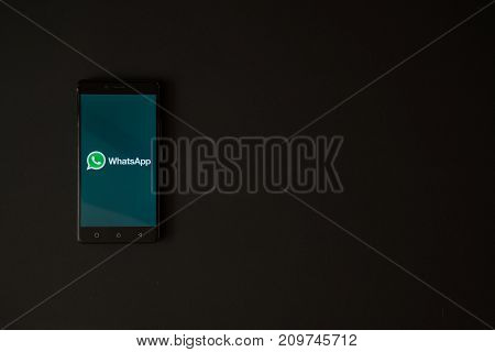 Los Angeles, USA, october 19, 2017: Whatsapp logo on smartphone screen on black background.