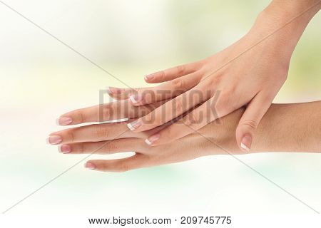 Hands classic manicure woman color white background