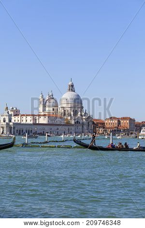 VENICE ITALY - SEPTEMBER 21 2017: Baroque church Santa Maria della Salute sea view. Basilica was built in the 17th century as a votive thanksgiving after the plague epidemic