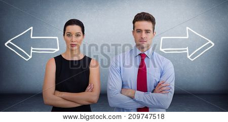Business colleagues posing with crossed arms  against grey room