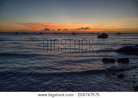 Evening sunset of the calm sea. Malay, Philippines
