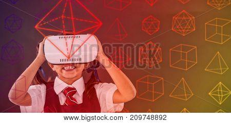 Math problems against schoolgirl using virtual reality headset against blackboard