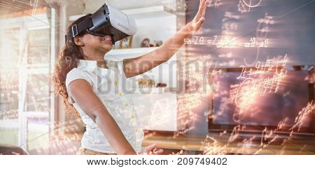 Illustration of mathematical equations  against smiling girl using virtual reality simulator in living room