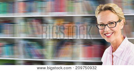 Portrait of smiling confident teacher against shelf of books