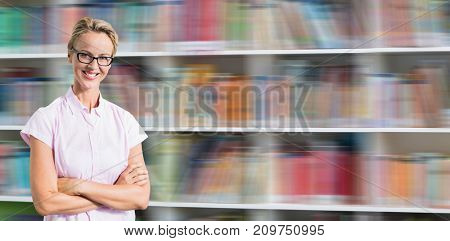 Portrait of smiling teacher against shelf of books