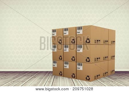 Composite image of cardboard boxes against room with wooden floor