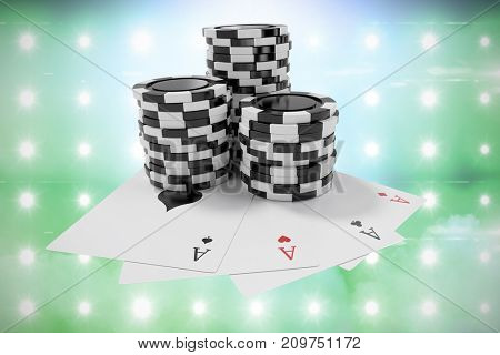 Black casino tokens with playing cards against illuminated blue floodlight