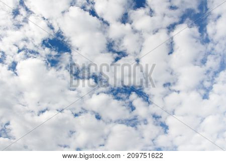 Photo of white cumulus cloudy sky in the summer