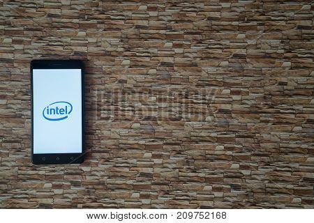 Los Angeles, USA, october 19, 2017: Intel logo on smartphone screen on stone facing background