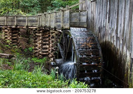 Historic gristmill in the Smoky mountains with waterwheel